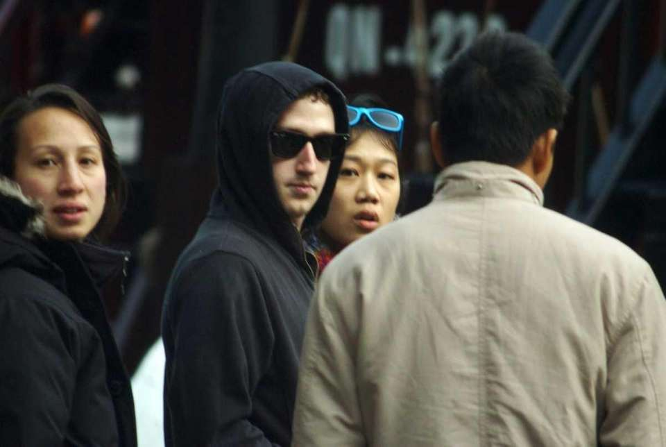 Facebook's founder and billionaire Mark Zuckerberg, in sunglasses,