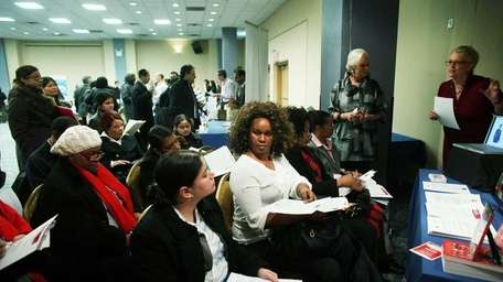 Job seekers attend a workshop at the New