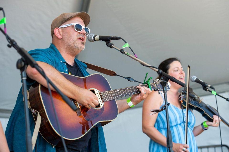 Singer and guitarist Jonathan Preddice at left performs