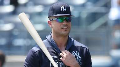 Yankees injured outfielder Giancarlo Stanton talks to Rockies