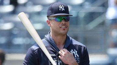 Yankees injured outfielder Giancarlo Stanton talks to Rockies