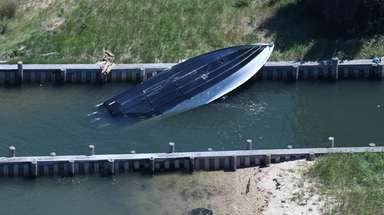 A boat crash sent its driver and two