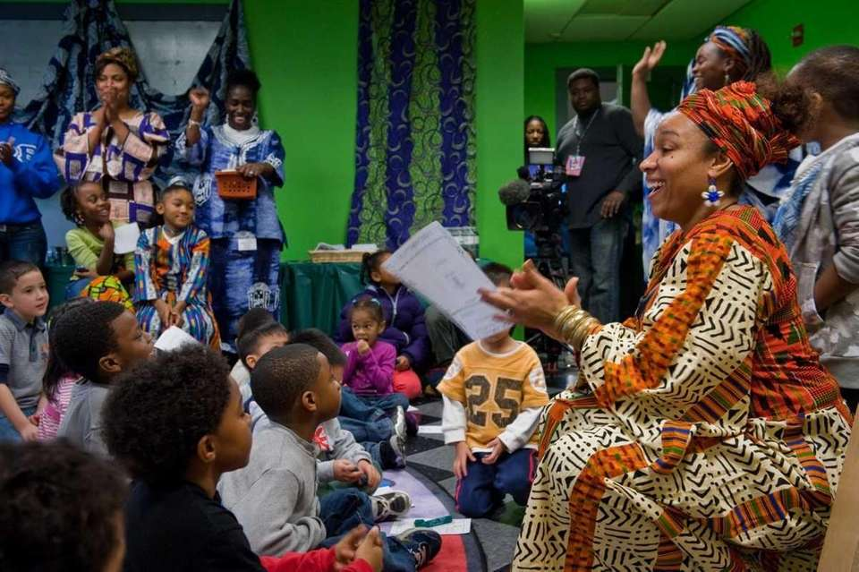 Tanya Bacchus, of Great Neck, explains to children