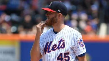 New York Mets starting pitcher Zack Wheeler reacts