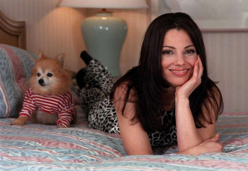 Fran Dresher is photographed with her dog, Chester,