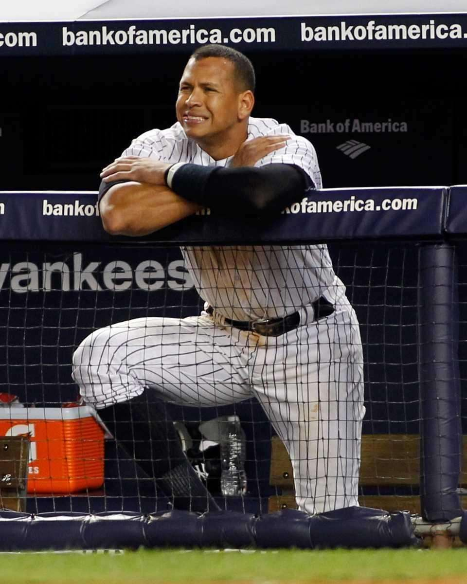 Alex Rodriguez watches from the dugout in the
