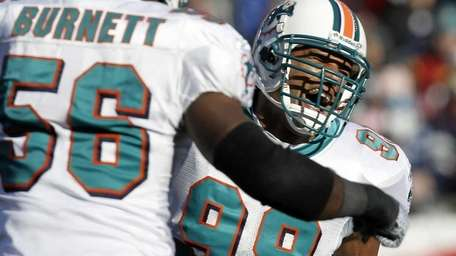 Jason Taylor #99 of the Miami Dolphins celebrates