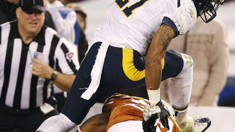 California wide receiver Keenan Allen hurdles Texas cornerback