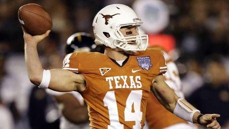Texas quarterback David Ash throws a pass against