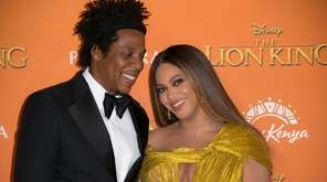 "Jay-Z, left, and Beyoncé at the ""Lion King"""