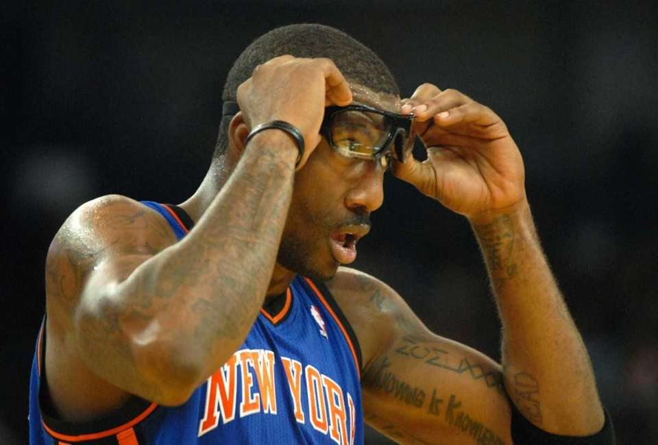 The New York Knicks' Amar'e Stoudemire clears his