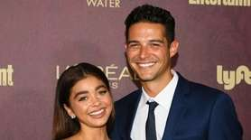 Sarah Hyland and Wells Adams arrive at the