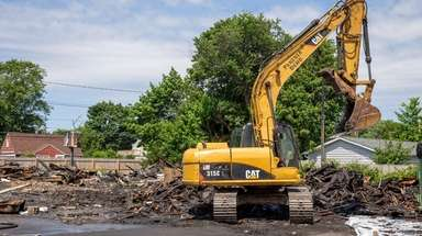 Piles of construction equipment are removed from the
