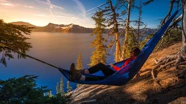 A hiker relaxes with an expansive view in