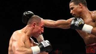 Andre Dirrell (R) takes a swing at Arthur