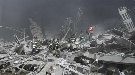 Firefighters and other first responders look for victims