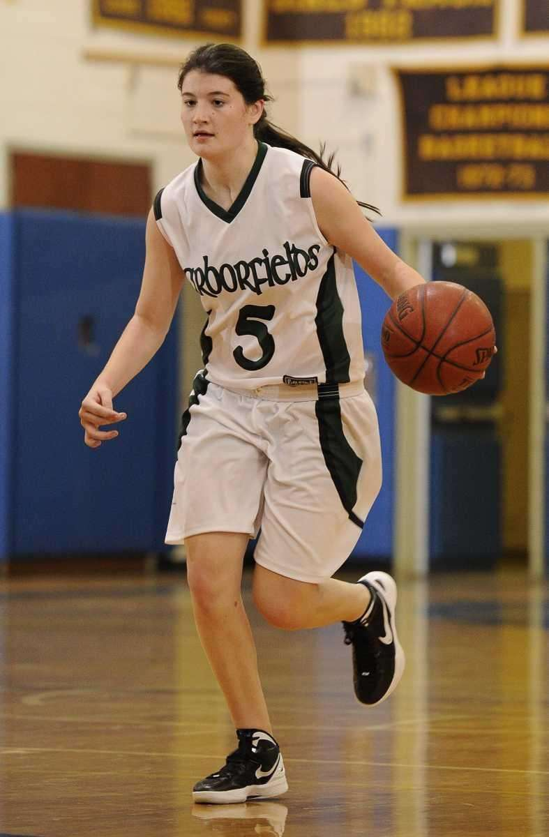 Harborfields' guard Alexia O'Connor takes the ball downcourt