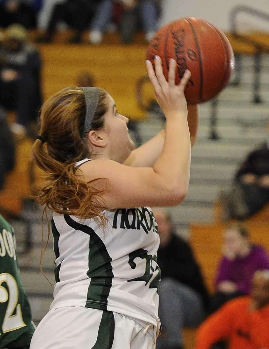 Harborfields' forward Sara Tane shoots against Longwood in