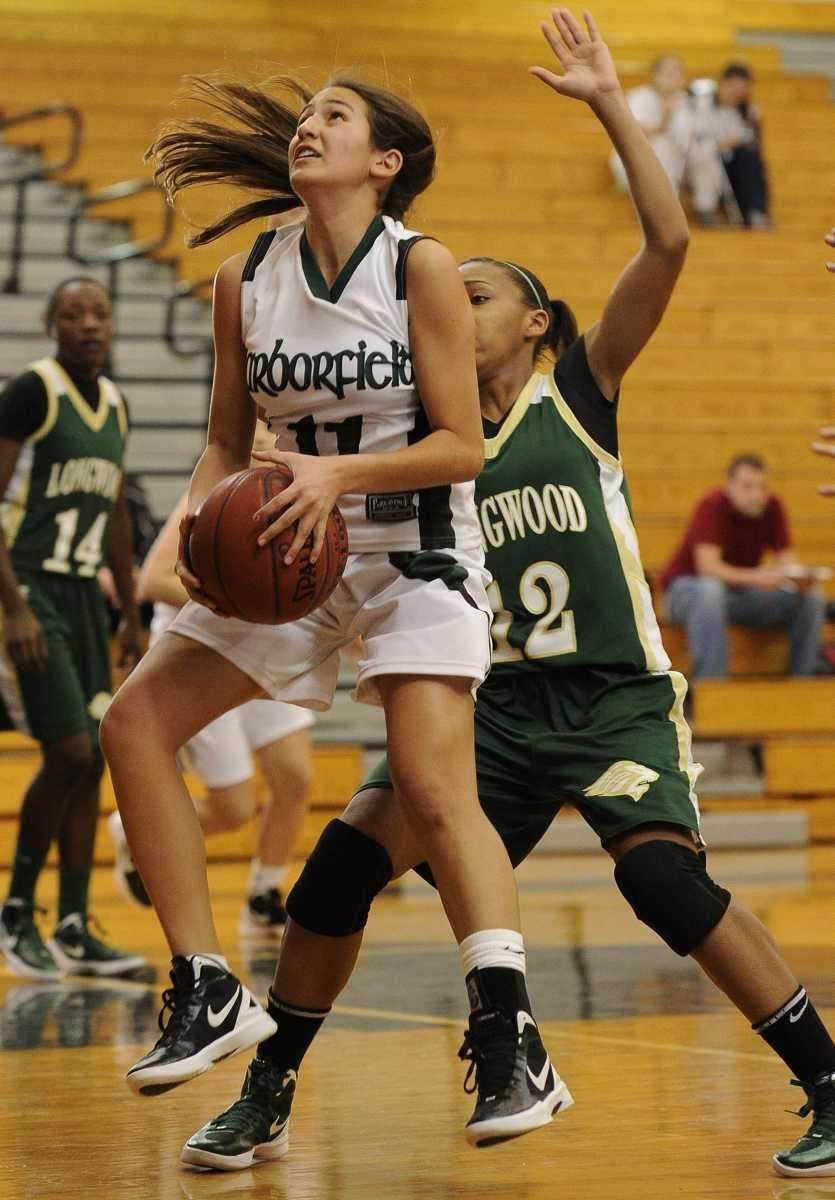 Harborfields' guard Julie Luxemberg grabs a rebound in