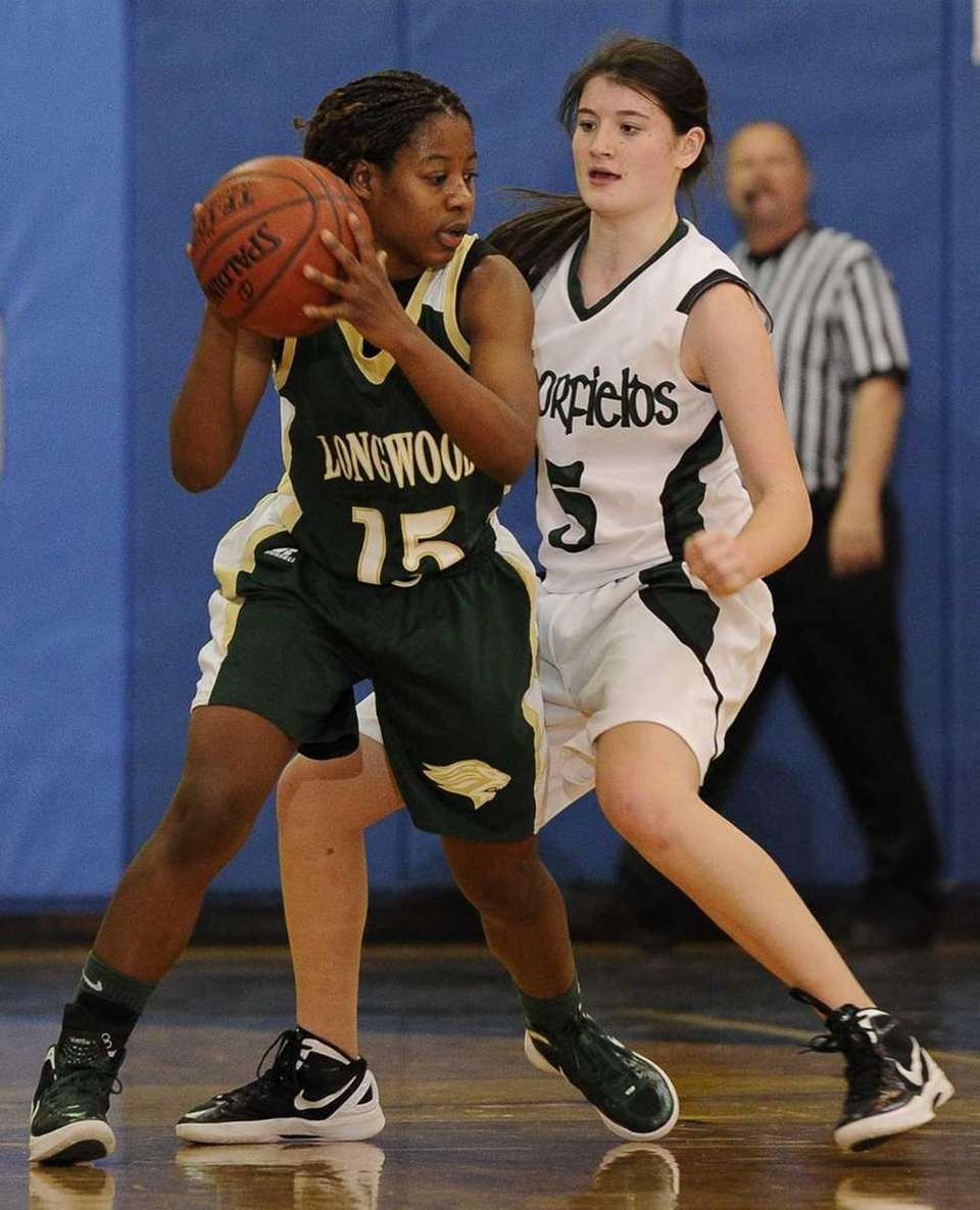 Longwood's guard Makeda DeSouza is guarded by Harborfields'