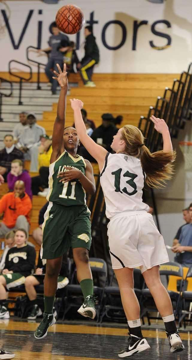 Longwood's forward Dakayla Bowlay-Williams shoots past Harborfields' forward