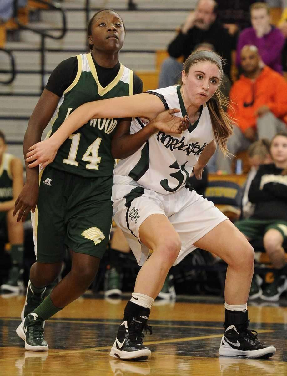 Harborfields' Kasey Stolba boxes out Longwood's Kiersten West