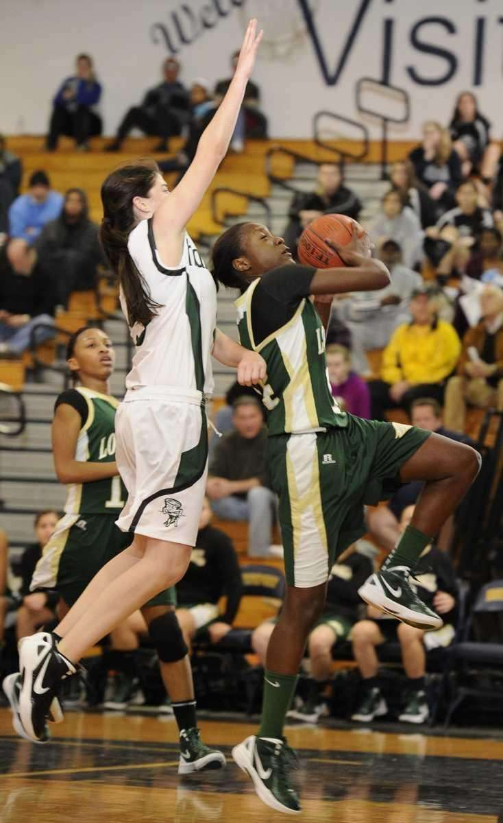 Longwood's guard Kiersten West goes up for a