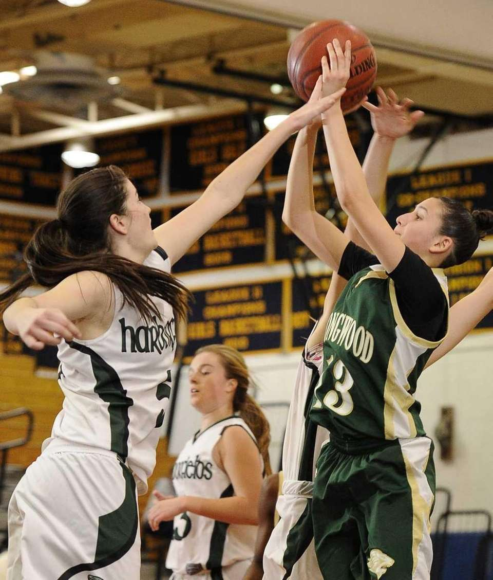 Longwood's Tiffany Ruiz shoots guarded by Harborfields' Alexia
