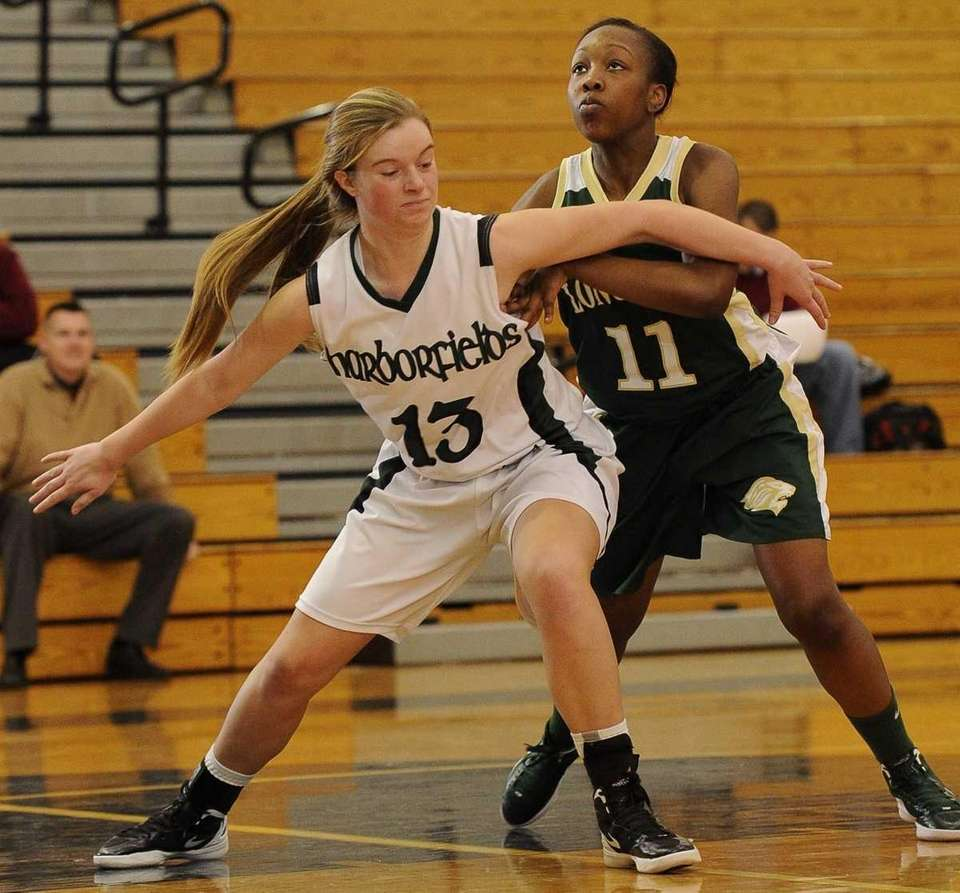 Harborfields' forward Amy Werbitsky boxes out Longwood's Dakayla