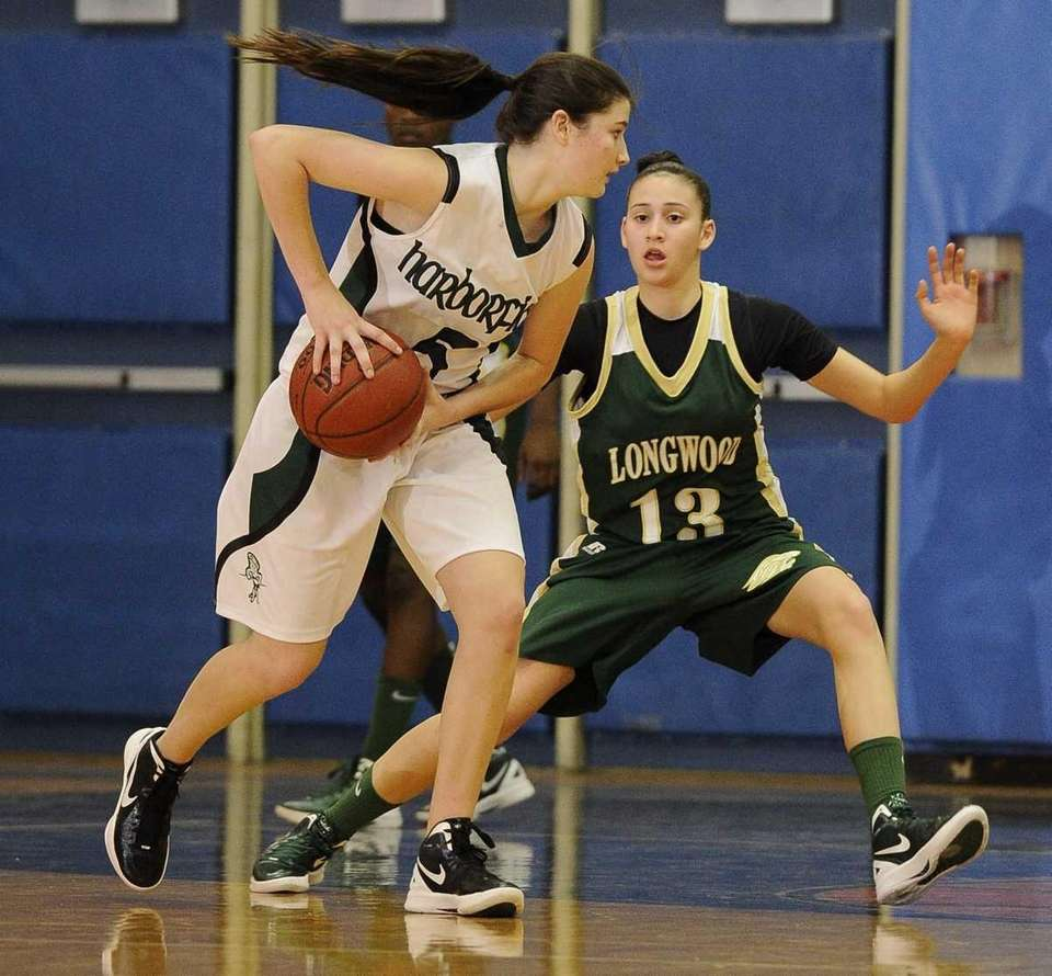 Harborfields' guard Alexia O'Connor protects the ball from