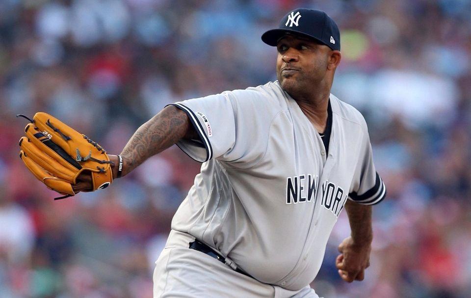 Yankees pitcher CC Sabathia delivers against the Twins