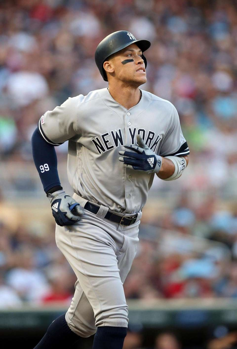 The Yankees' Aaron Judge heads to first base