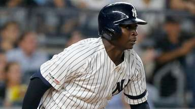 Yankees shortstop Didi Gregorius follows through on a