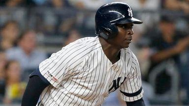 Yankees shortstop Didi Gregorius follows through on a