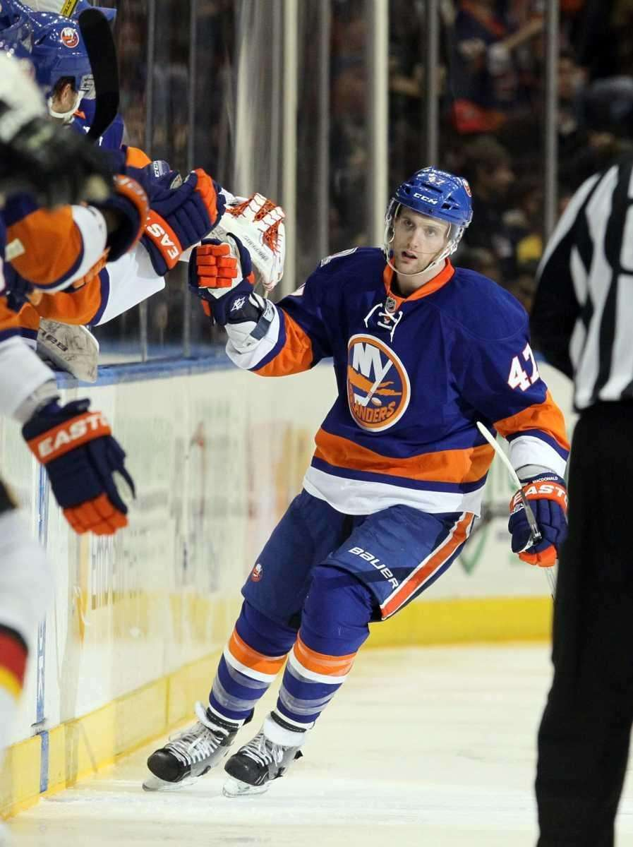 Andrew MacDonald of the Islanders celebrates his second