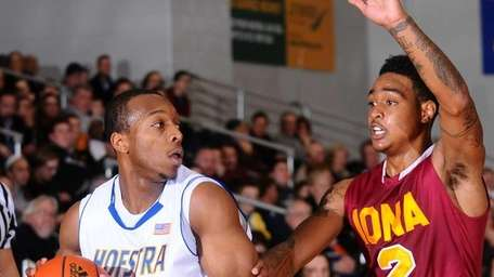 Hofstra University #1 Nathaniel Lester, left, gets pressured