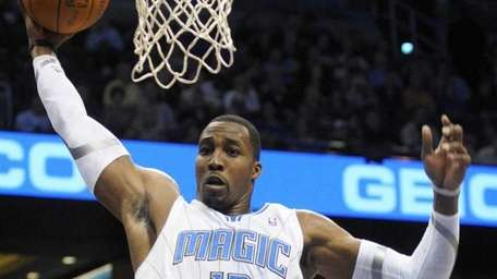 Orlando Magic center Dwight Howard (12) grabs a