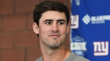 Giants quarterback Daniel Jones answers questions from the