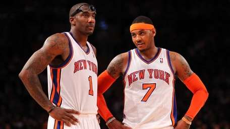 Amare Stoudemire and Carmelo Anthony talk during their