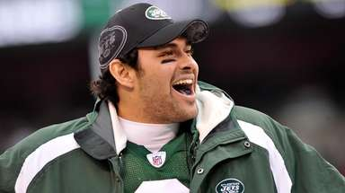 Mark Sanchez smiles on the sideline after the