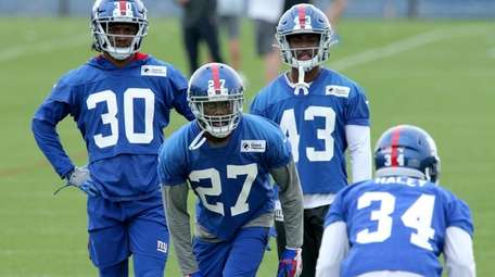 Giants cornerback DeAndre Baker participates in drills during