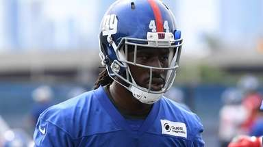 Giants defensive end Markus Golden participates in a