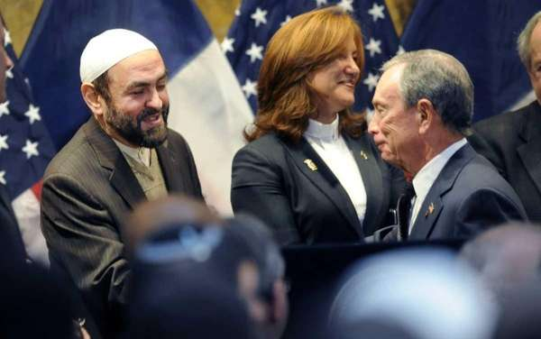 New York Mayor Michael Bloomberg, right, shakes hands