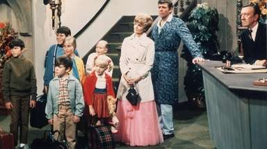 "The cast of ""The Brady Bunch"" from the"