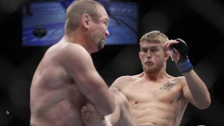 Alexander Gustafsson, of Sweden, right, lands a kick