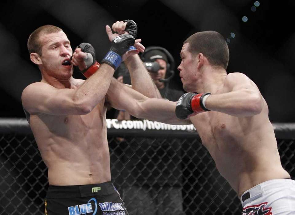 Nate Diaz, right, punches Donald Cerrone during the