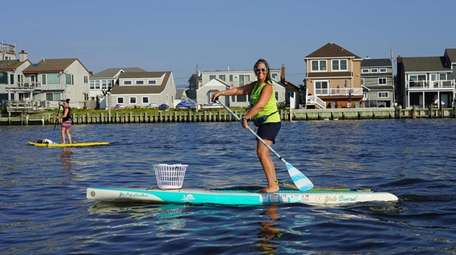 South Shore Paddleboards owner Karen Marvin organizes weekly