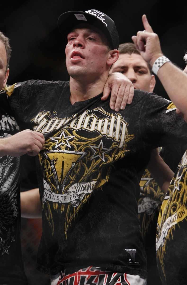 Nate Diaz celebrates his unanimous decision victory over