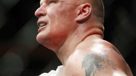 Brock Lesnar reacts to his first round TKO