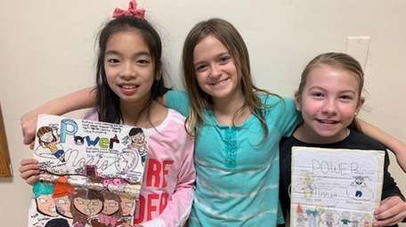 Kidsday reporters Eva Lam, left, Shannon Mahoney and